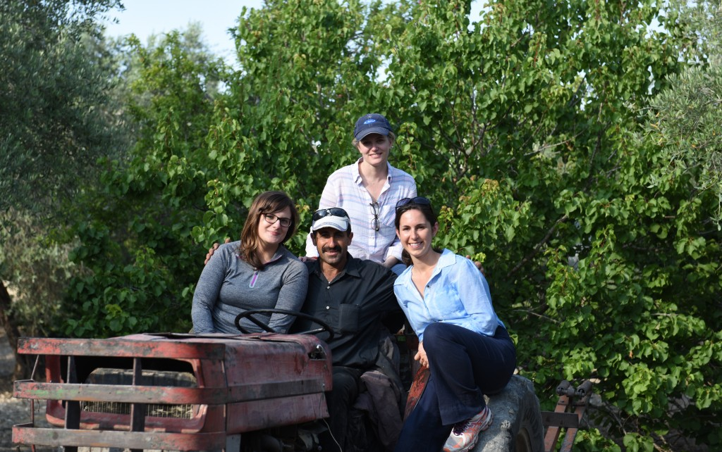Brittany Wait, Jennifer Swanson and Christine Rushtion get a picture with Nahed Kayed on his tractor, as per request.